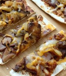 Flank Steak and Caramelized Onion Flatbread Recipe www.InTheKitchenWithKP slider